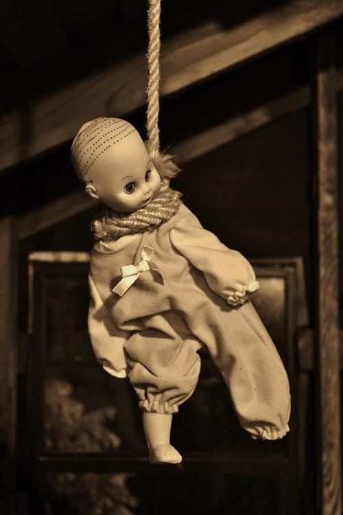 Baby doll hanging from a rope, in Jennifer cabrera's attic, to create a creepy effect.