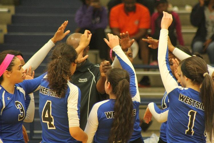 Volleyball+players+getting+ready+to+play+against+Lamar+and+cheering+with+Coach+King%0A
