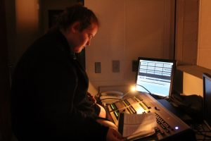 Elizabeth George runs the light board during this year's production of Miracle on 34th Street.