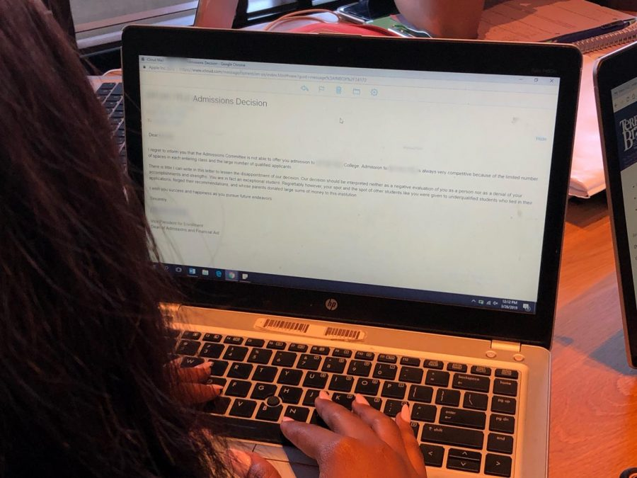 Student reads her letter of denial from a college she applied to.