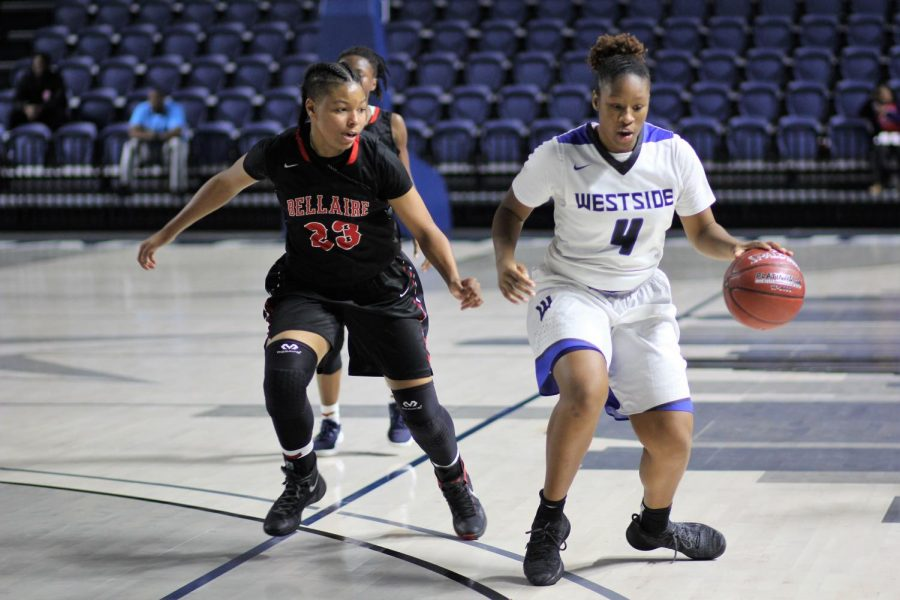 Senior Kameryn Lewis controls the ball against rival school Bellaire. Picture from the 2019 season.
