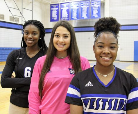 Three standout Lady Wolves. Kylah Carter, Angel Chase, and Alyssa Woods.