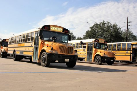 The Westside bus parking lot waits for the afternoon bell to ring.