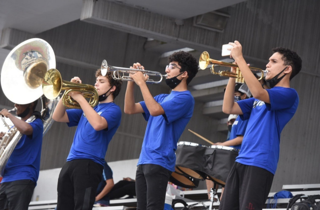 A portion of the Wolf Band returns playing for the Westisde's varisty football's game against Chavez. (From right to left the students are: Alejandro Estrada, Estevan Villagrana Ocasio, and Bjorn Wessels)