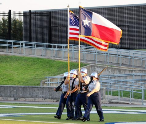 JROTC Color Guard posts the colors at Westsides first football game of the season